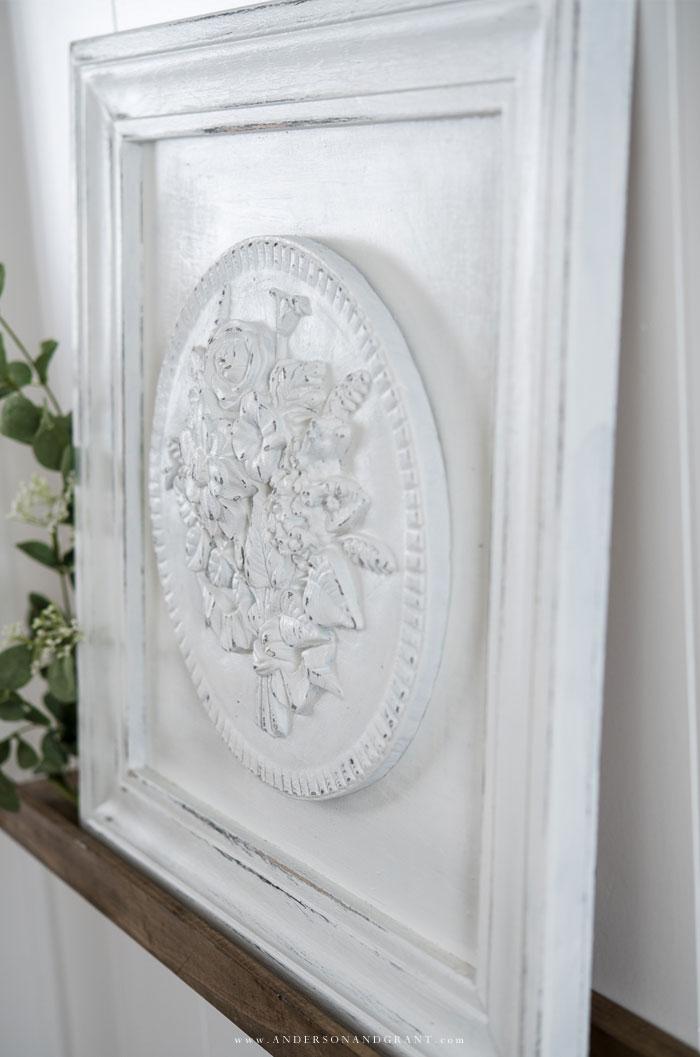 Round plaster medallion in frame
