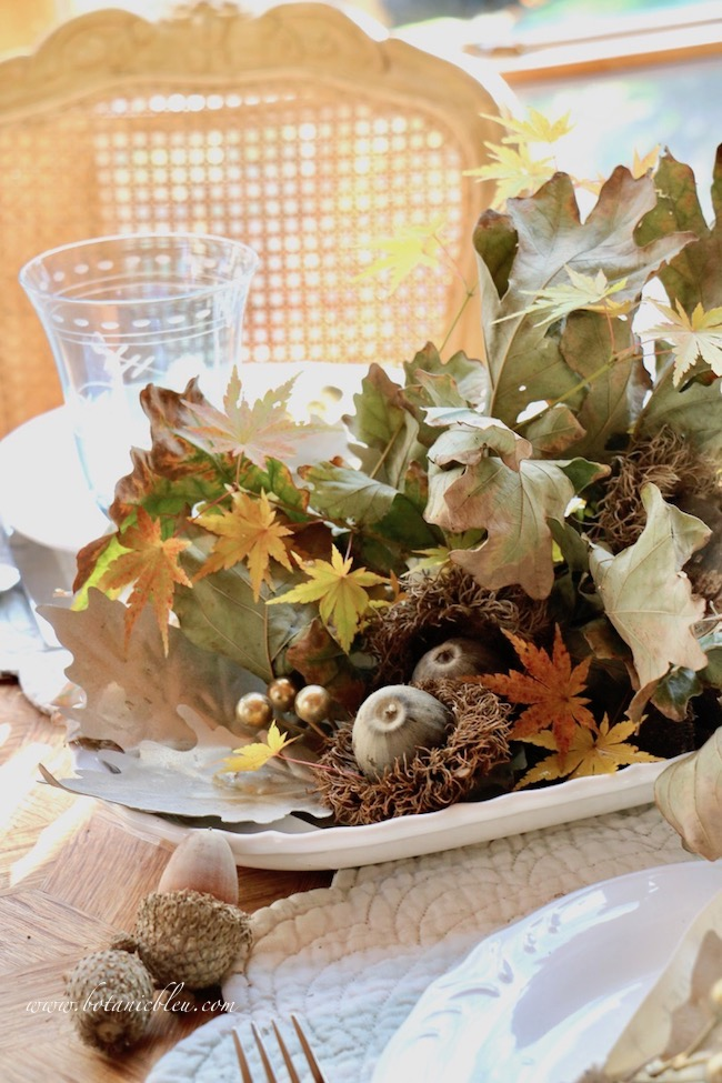 Thanksgiving Natural Centerpiece tips for using twigs, leaves, and acorns include using the shape of the leaves to decide the position of the branch