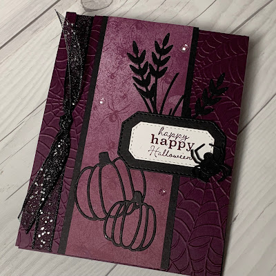 Halloween Card with two pumpkins spiders and spider webs with a glittery black ribbon