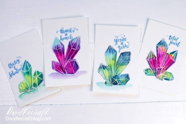 Learn to paint watercolor galaxy crystals in a few easy steps.