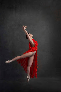 A Beautiful Ballerina in Motion Wearing a Flowing Red Dress