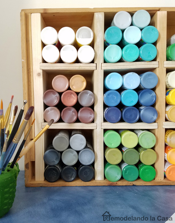 how to repurposed a wine crate into a craft storage box - colorful paint bottles - little brushes in brush holder
