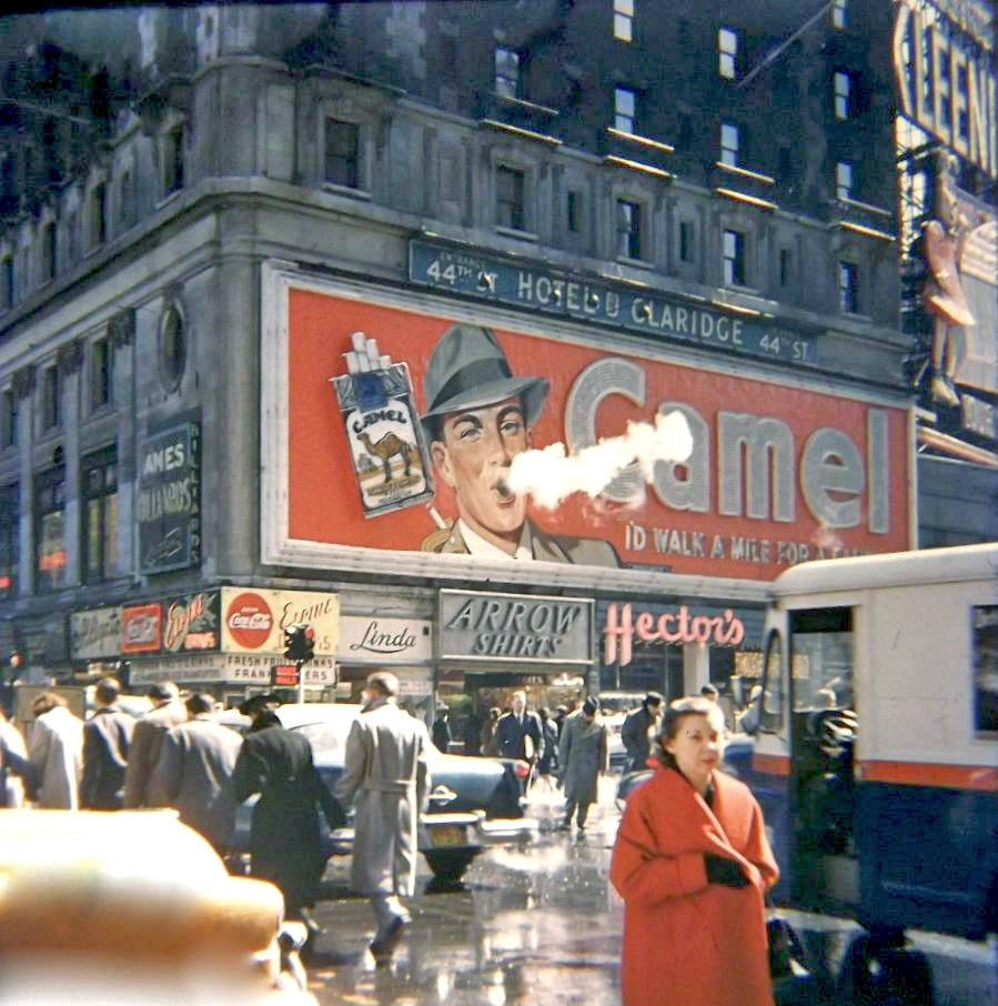 colorizing history  times square 1943  smoking camel sign