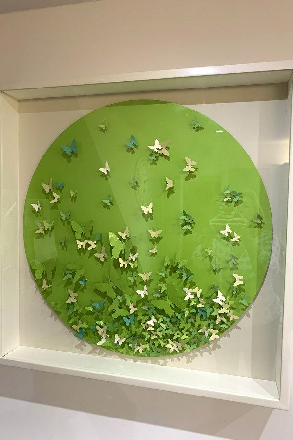 circular handpainted dimensional paper butterfly collage in white shadow box