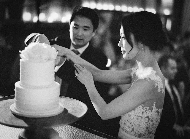 Cutting the cake at Jihyea and Ben's intimate wedding at Locanda Verde | Karen Hill Photography