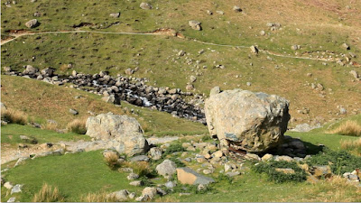The large rock that is the only remaining section of the Easedal Tarn tea hut, as featured in Walks Around Grasmere, a Jonathan Craig Guide