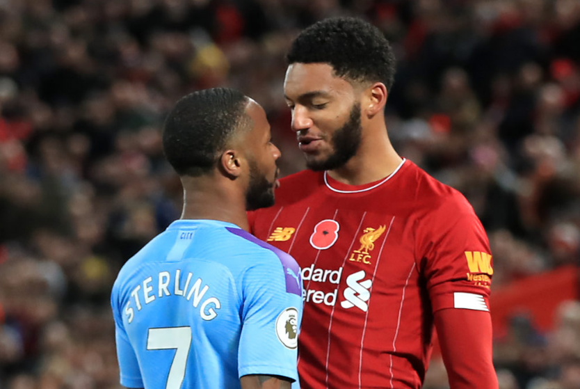 City's Raheem Sterling and Liverpool's Joe Gomez clash in the EPL