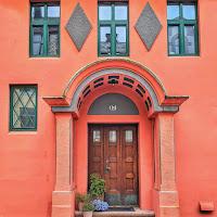 Orange Art Nouveau doorway in Alesund Norway