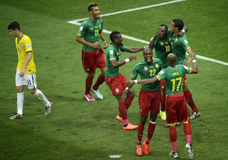 Cameroon's Joel Matip, right, celebrates with team mates after scoring his side's first goal during the group A World Cup soccer match between Cameroon and Brazil at the Estadio Nacional in Brasilia, Brazil, Monday, June 23, 2014.