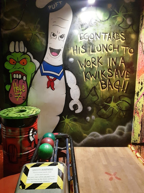 Slimer and a Stay Puft Marshmallow Man on a tenpin bowling themed hole at Ghetto Golf in Liverpool