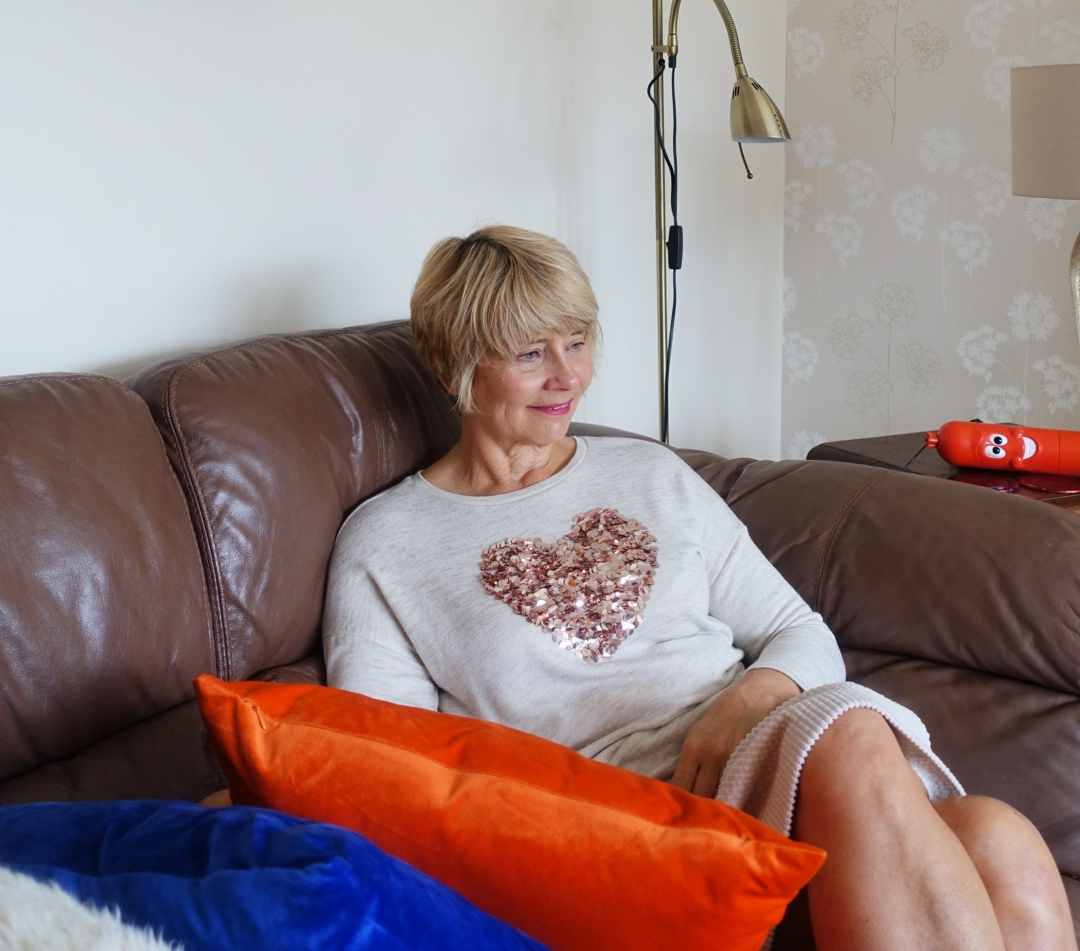 Over 45s blogger Gail Hanlon in relaxing at home outfit of sequin heart jumper by TU at Sainsburys and cord Boden skirt