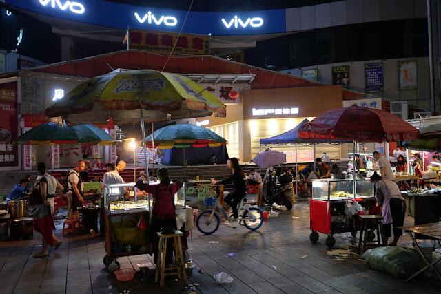 outdoor market at night in Yulin, China