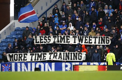 Rangers fans unfurl banner 'Less time tweeting, more time training'