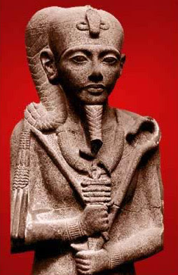 Khonsu wearing the uraeus crown, and holding the crook and flail.