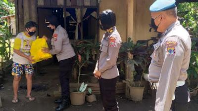 Polres Minut Bagikan Sembako di Desa Mapanget