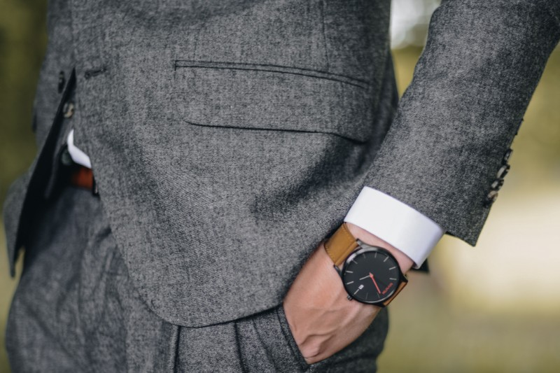 men in grey suit and watch.