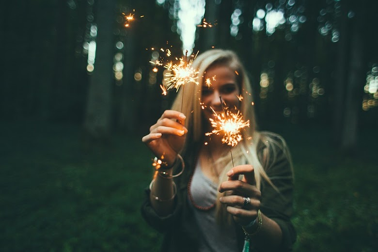 Girl play with fireworks in nature