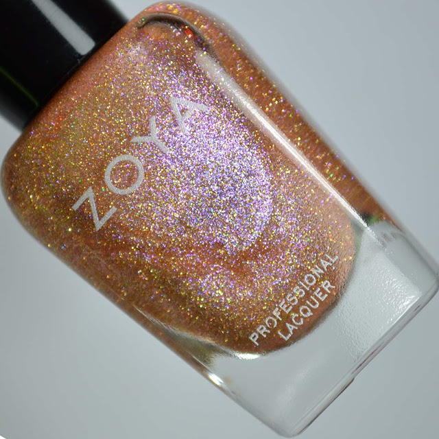 rose gold holographic nail polish in a bottle