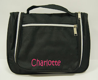 black Toiletry bag with name embroidered on its outside