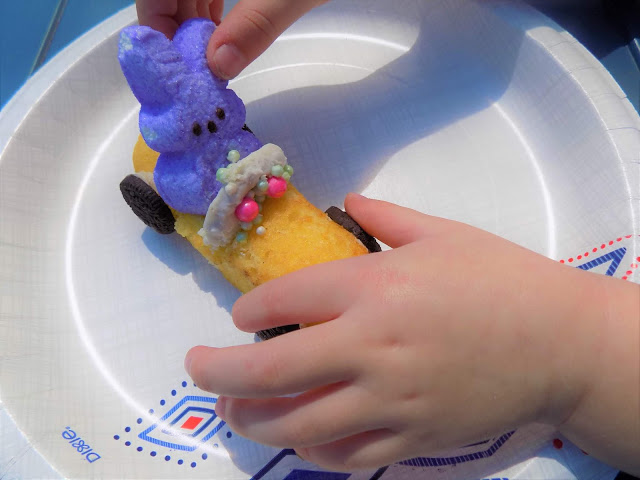 A picture of a child assembling an Easter Bunny Car