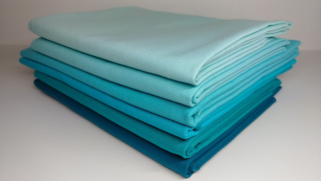 Kona solid fabrics in aqua and turquoise