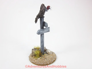 Vulture sitting atop sign post for 25-28mm scale miniature wargaming UniversalTerrain.com - right side view