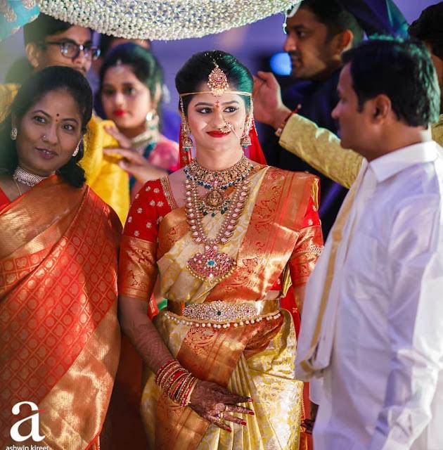 Bride in Mango Mala Polki Diamond Odiyanam