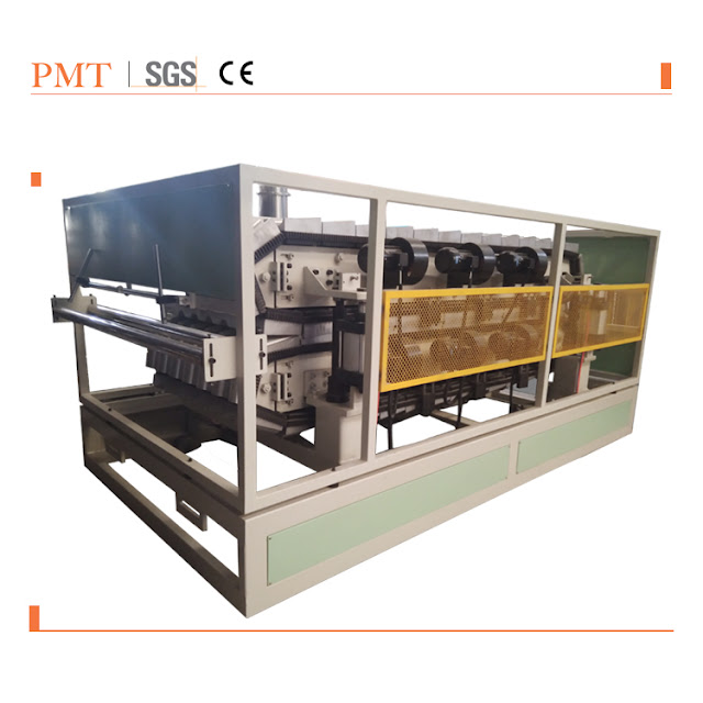 Synthetic resin tile 3: The tile forming machine in light green.