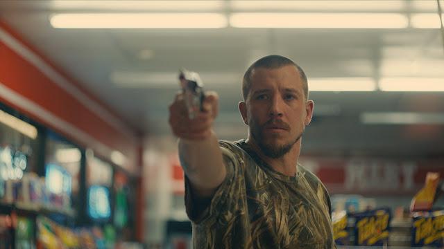 Beau Knapp with a gun