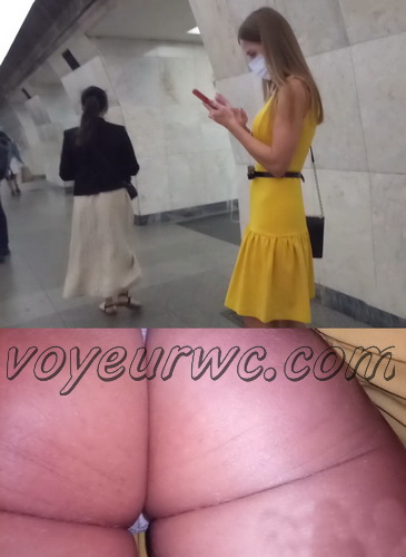 Upskirts 4479-4488 (Secretly taking an upskirt video of beautiful women on escalator)