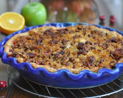 Cranberry Apple Pie, tart cranberries, sweet apples and brandy-soaked currants with a streusel topping, bright with citrus and ginger. The filling makes a great wintry apple crisp too! Recipe, tips, nutrition and Weight Watchers points at #KitchenParade.