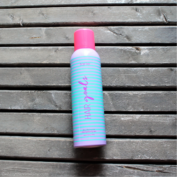 can of tarte Hair Goals dry shampoo lying on a table