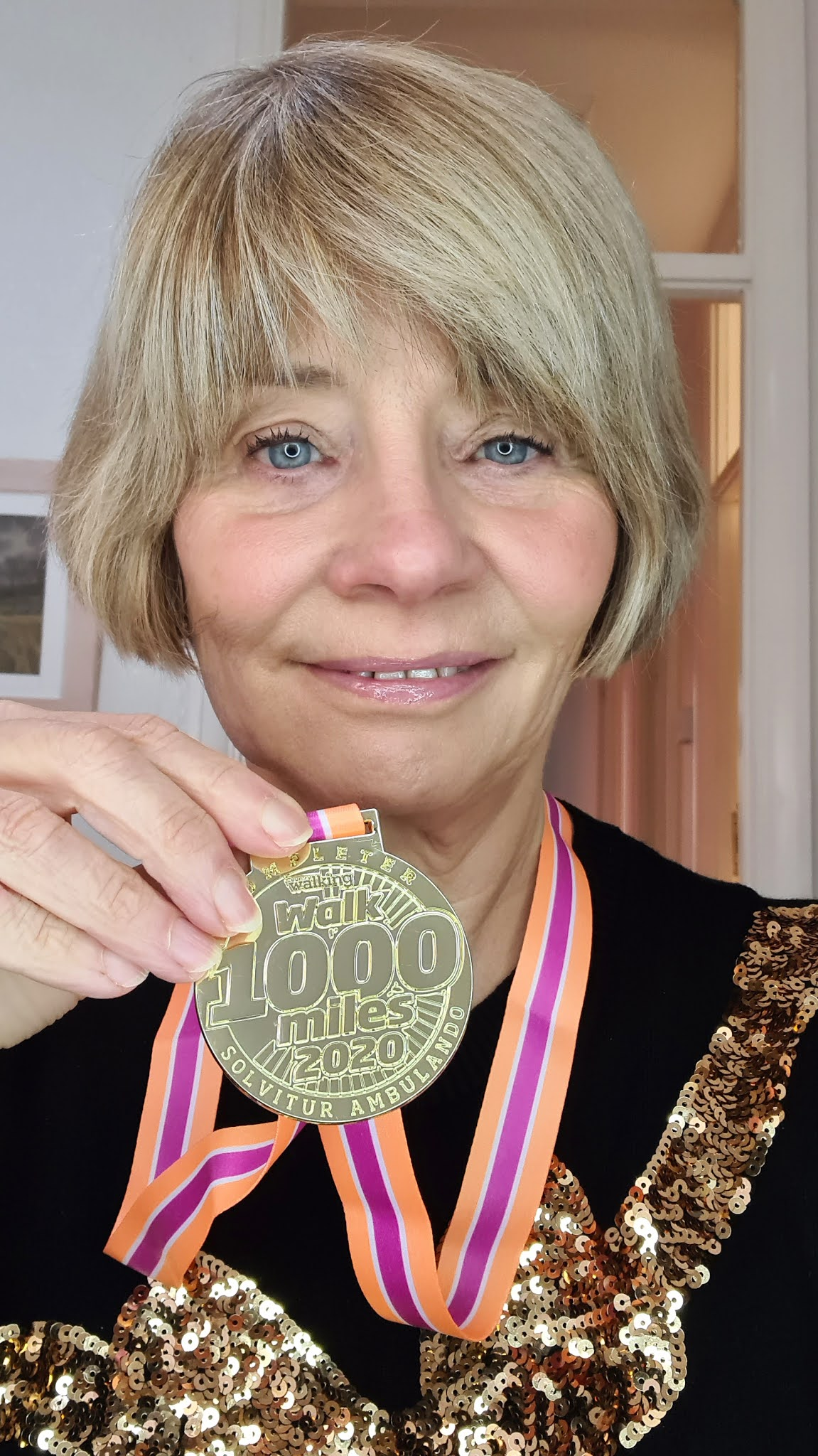 Gail Hanlon from style blog Is This Mutton with her completers' medal for the #Walk1000Miles Challenge 2020