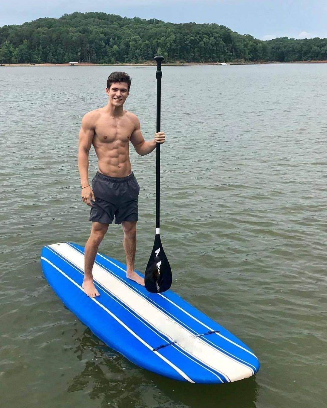 hot-young-shirtless-fit-surfer-water-ocean-smiling