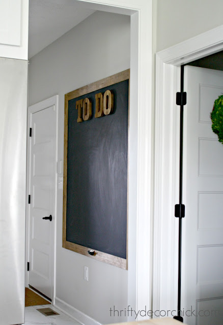 Big DIY chalkboard in mud room!