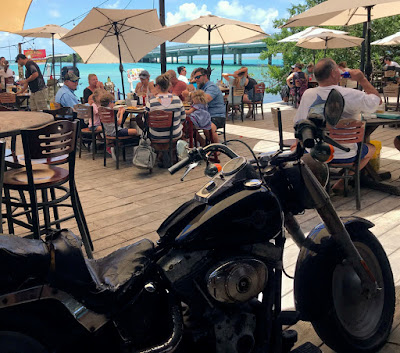 Beat up Harley-Davidson in outdoor restaurant.