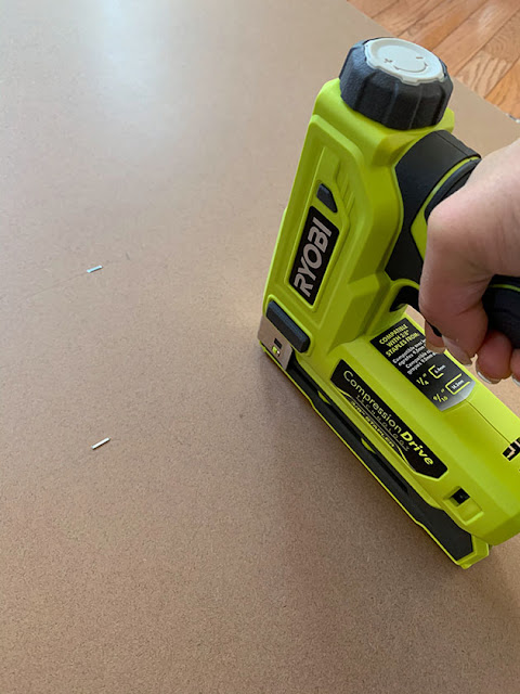 Ryobi stapler for installing backer onto shelf house