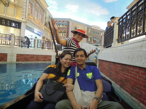A couple travel blogger enjoying a gondola ride at The Venetian Hotel Macao
