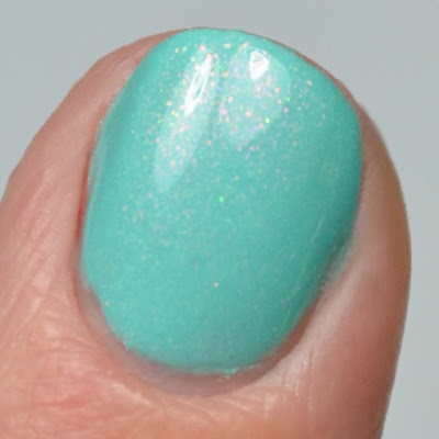 teal shimmer nail polish close up