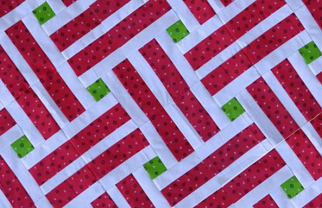 Laying Tracks quilt in red and green fabrics