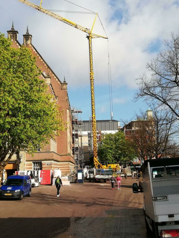 All attention to the construction crane-giraffe.