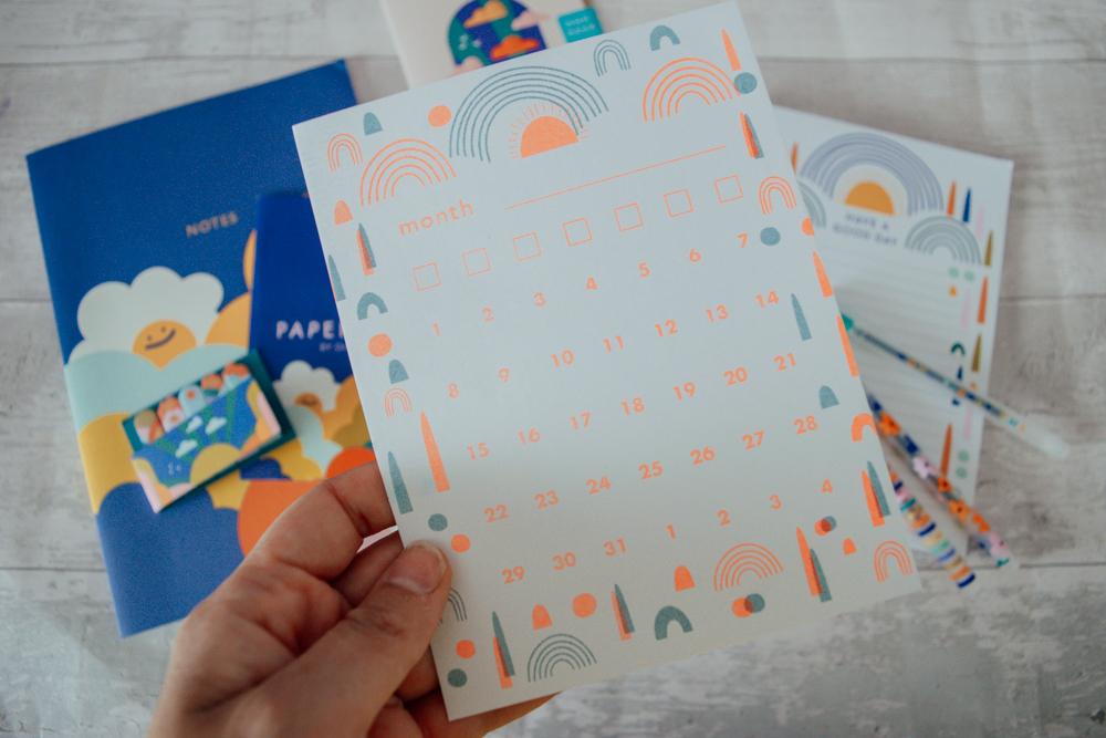Blank calendar card being held up