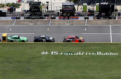 A view of pit road is seen with an #IStandWithBubba stencil (#NASCAR)