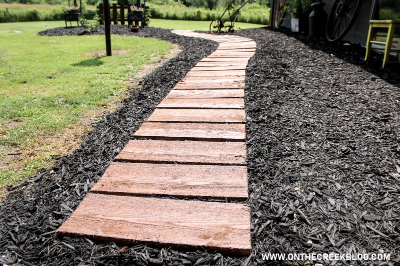 A stained wood rustic pathway made from rough cut lumber!