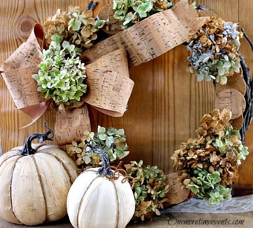 Using round cork pieces and faux cork ribbon to create a fall Wreath at One More Time Events.com