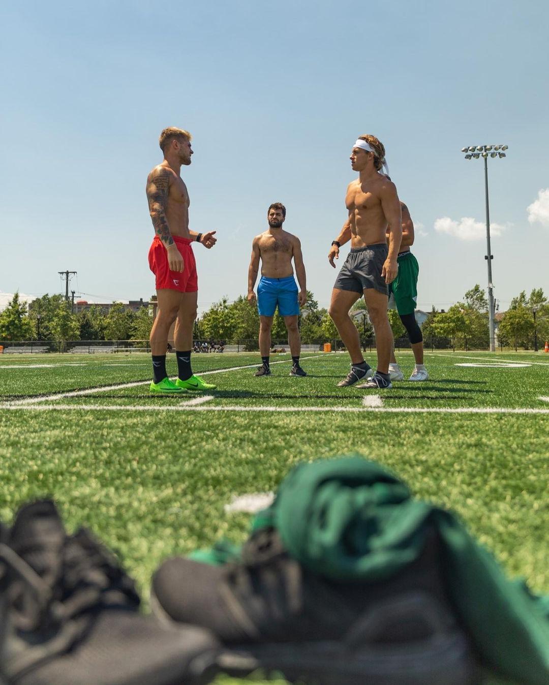 hot-guys-sneakers-playing-field-sportmen-hunks-devon-levesque