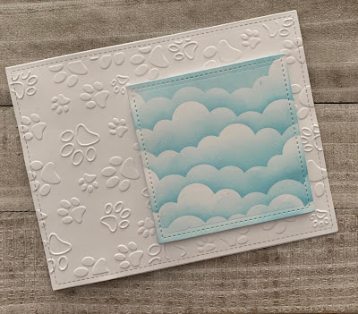 Paw Print Embossing and Clouds