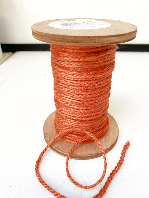 spool of orange jute