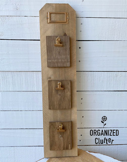 Photo of fence board with 3 mini clipboards and metal tag frame