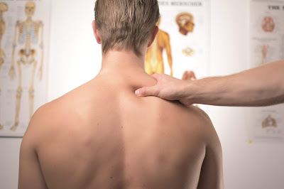 Man-showing-his-spinal-area
